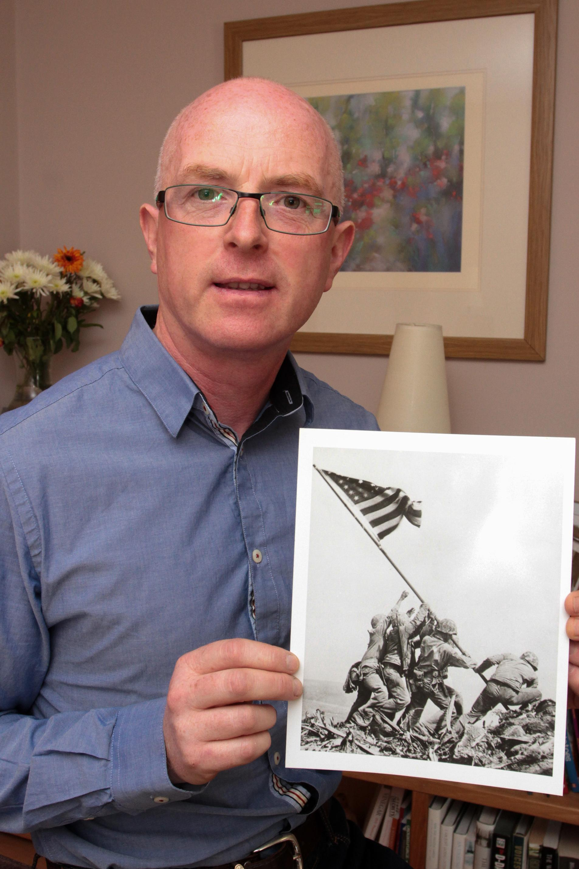 STEPHEN FOLEY:  an amateur Irish historian, on disability leave, leads the Marine Corps to the stunning renaming of the participants in the iconic Joe Rosenthal picture of the second flag raising on Iwo Jima