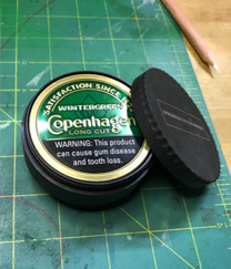 Gunner's custom dip container… that he won't need cause he's quitting!
